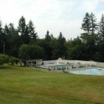 Sunning lawn, sauna building, hot tubs, pool and wading pool area